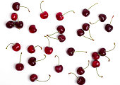 Cherry scattered on a white background, top view