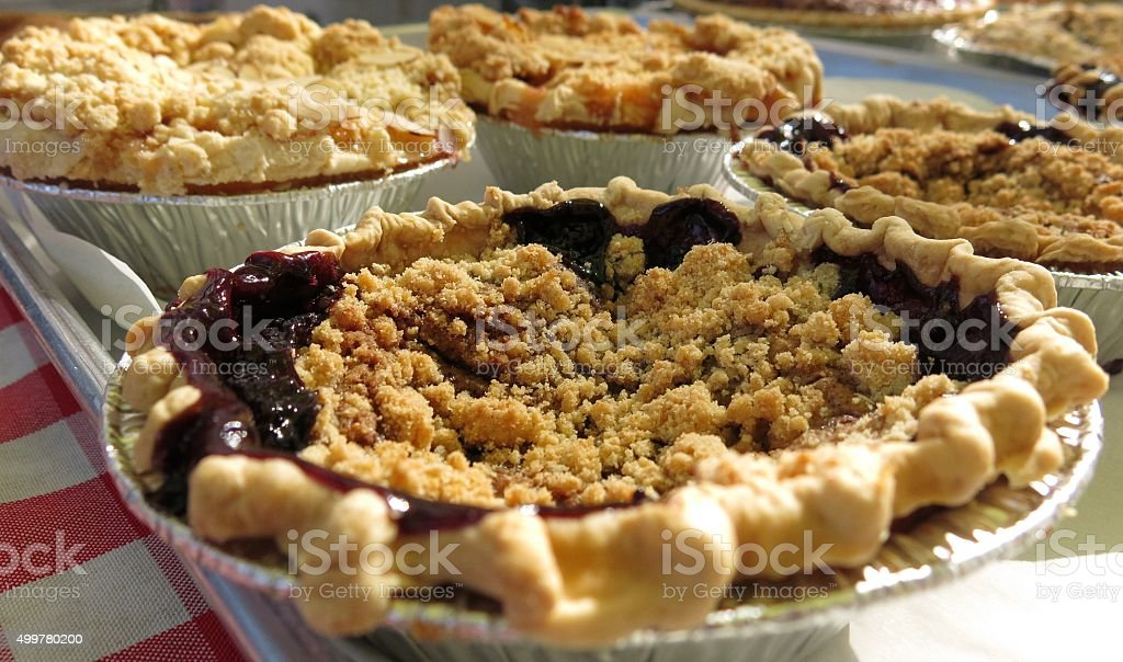 cherry pie All-American dessert on checked tablecloth stock photo