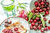 Cherry Pie And Fresh Organic Cherries with Glass of Mint Water