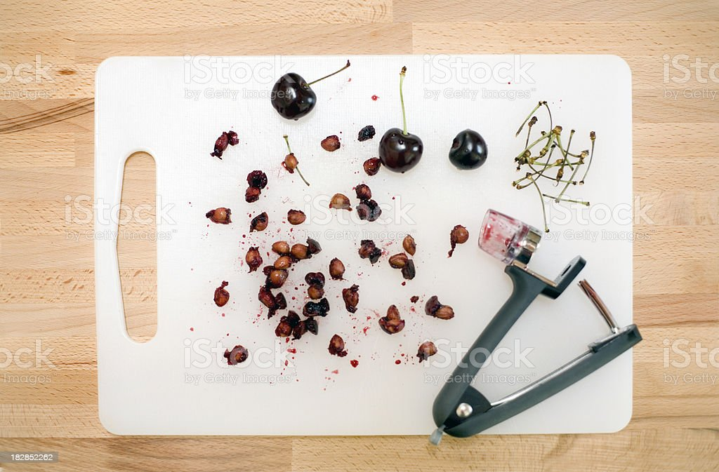 cherry pits and stems stock photo
