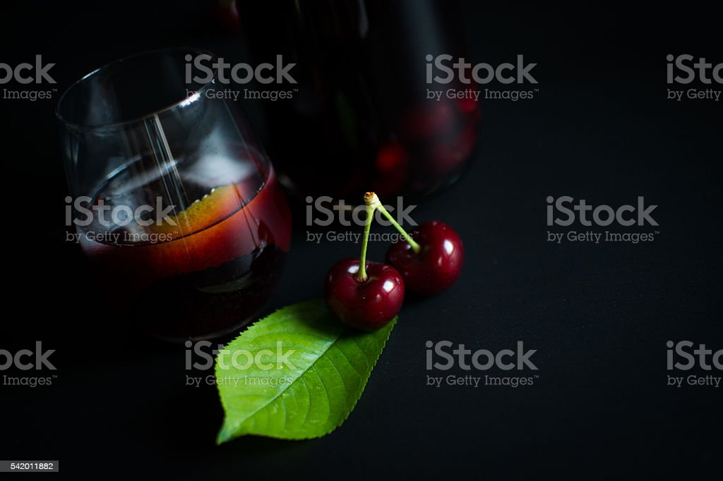Cherry Sangria In Glassware on black stock photo