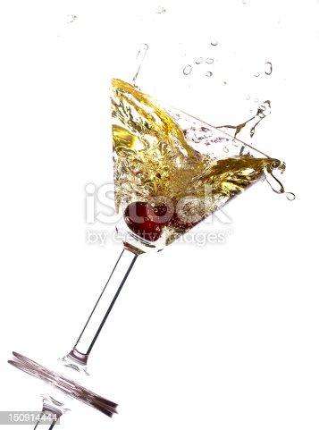 Cherry splashing into martini glass