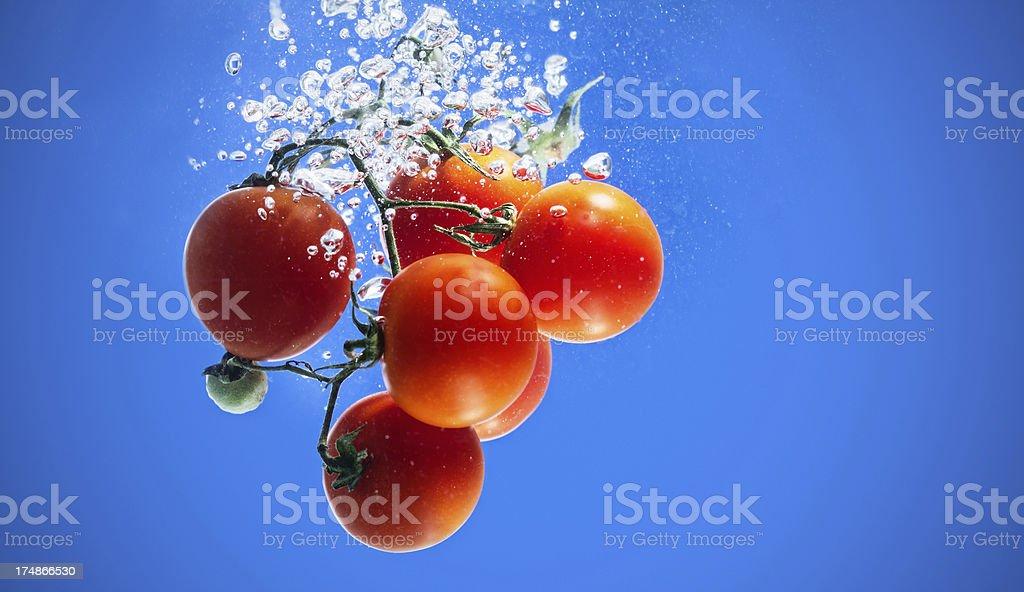 Cherry Tomato in water stock photo