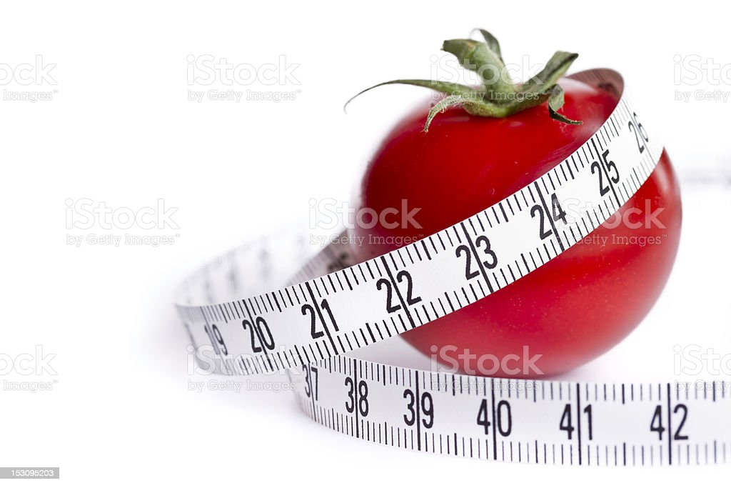 cherry tomato with tape measure royalty-free stock photo