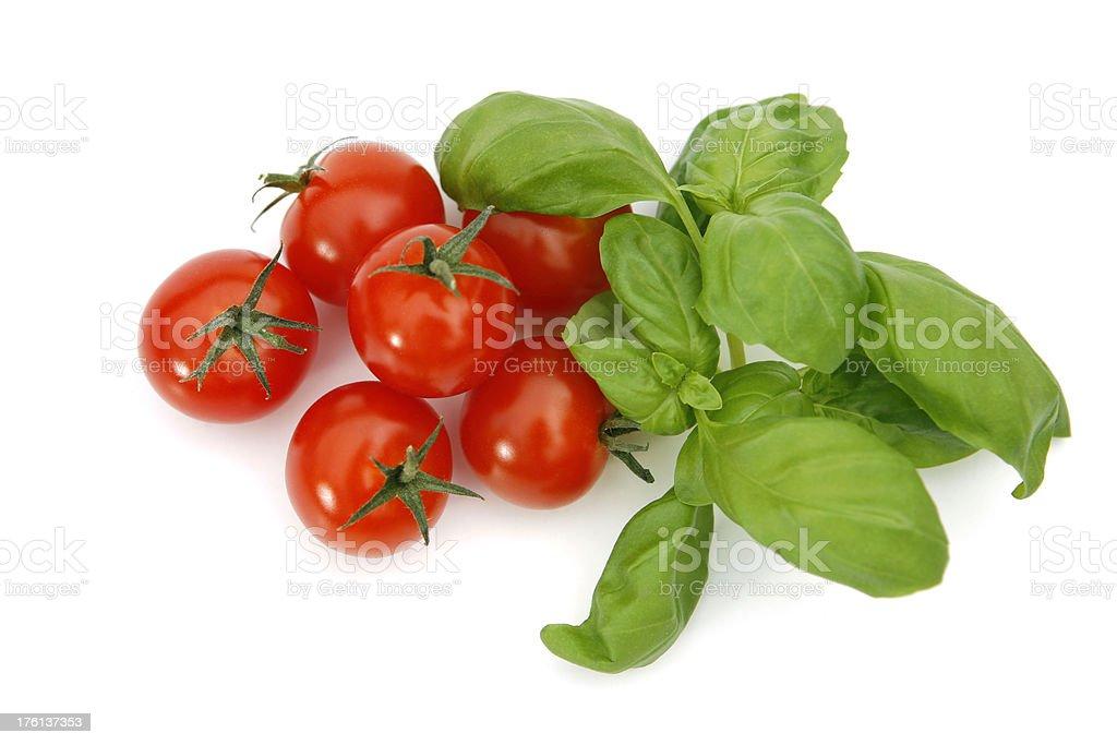 Cherry tomatoes and fresh basil royalty-free stock photo