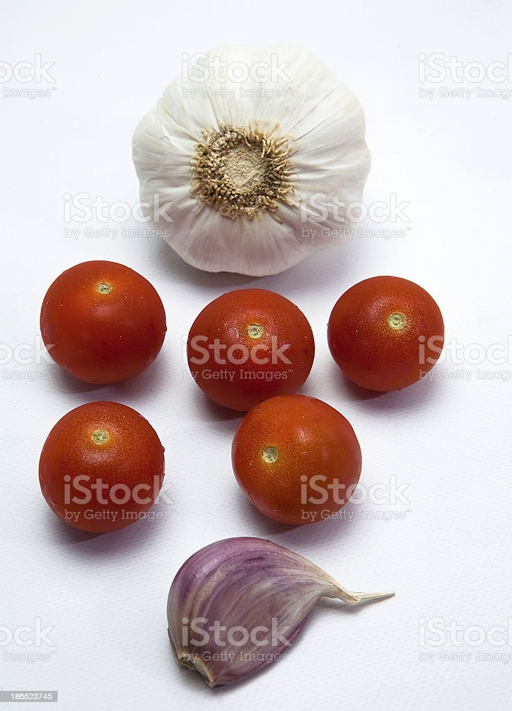Cherry tomatoes and garlics royalty-free stock photo