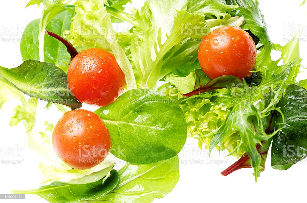 Cherry tomatoes and mixed lettuce on white stock photo