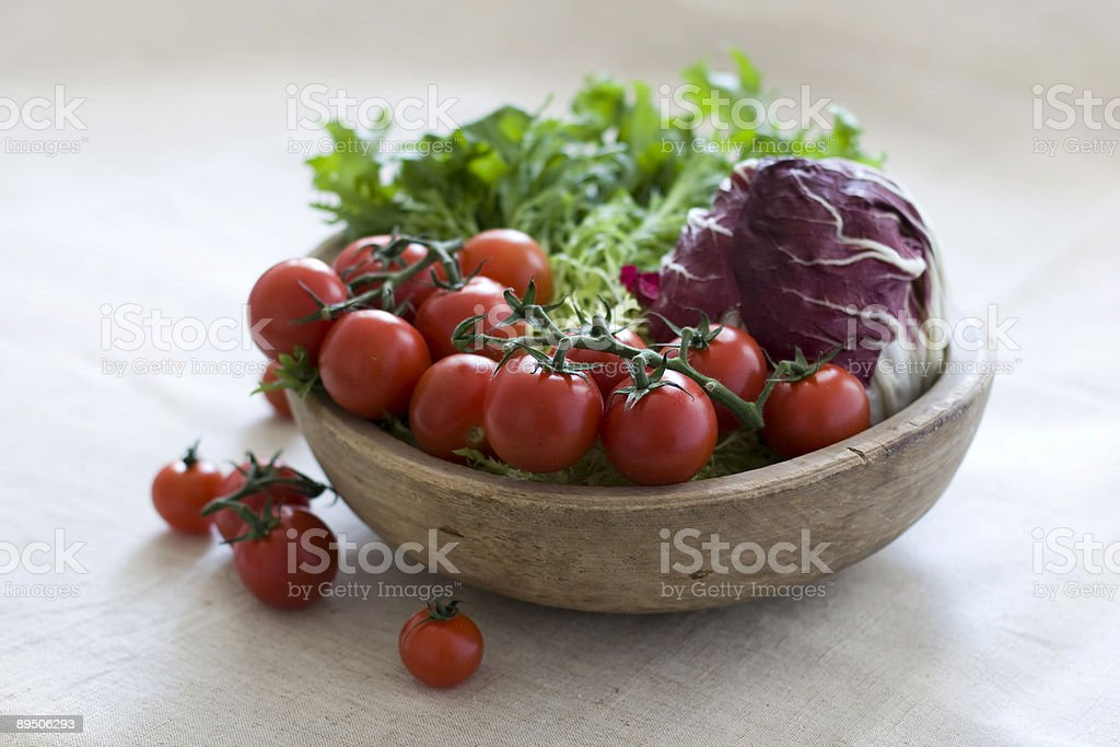 Cherry tomatoes and salad royalty-free stock photo