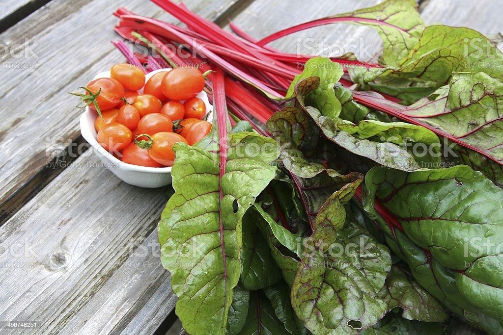 Cherry tomatoes and swiss chard stock photo