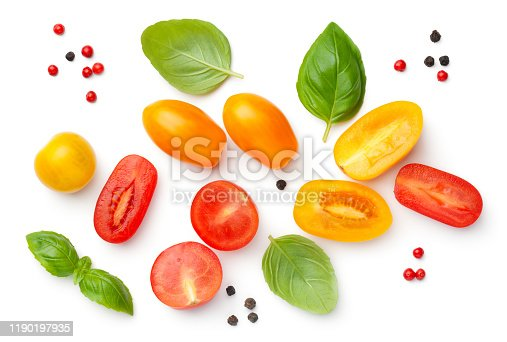 Cherry tomatoes composition with basil and peppercorns isolated on white background. Red and yellow tomato. Top view, flat lay