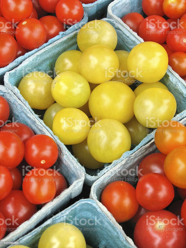 Cherry tomatoes for sale at a farmers' market royalty-free stock photo