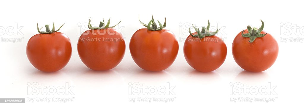Cherry Tomatoes In A Row royalty-free stock photo
