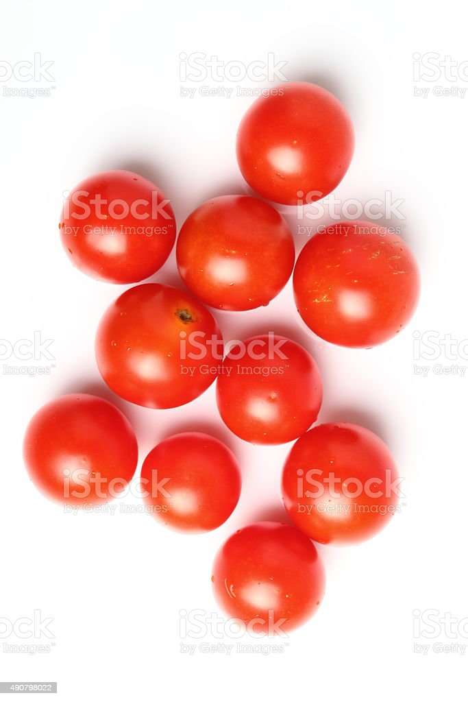Cherry tomatoes isolated on a white background. Directly above. stock photo