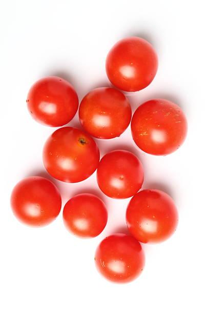 cherry tomatoes isolated on a white background. directly above. - körsbärstomat bildbanksfoton och bilder