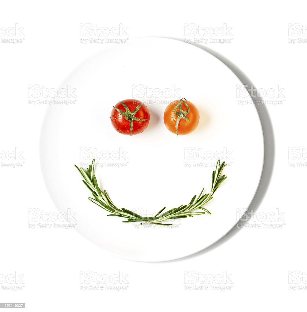 cherry tomatoes making smiley face royalty-free stock photo