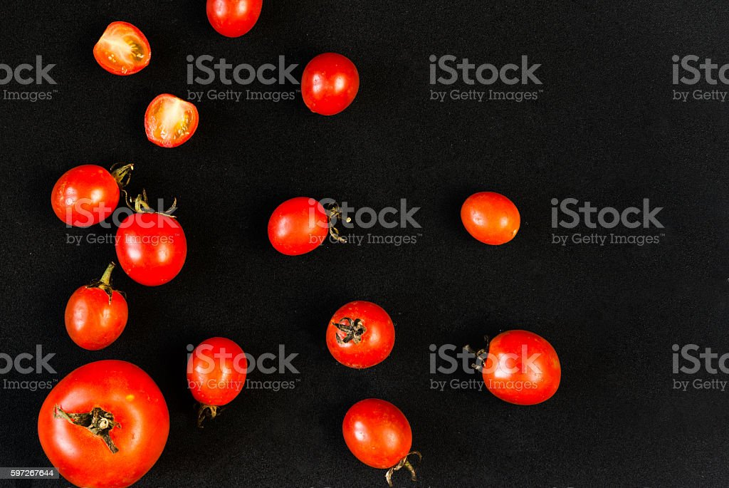 Cherry tomatoes on a black background royalty-free stock photo