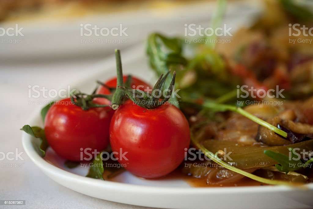 Cherry Tomatoes on a plate stock photo