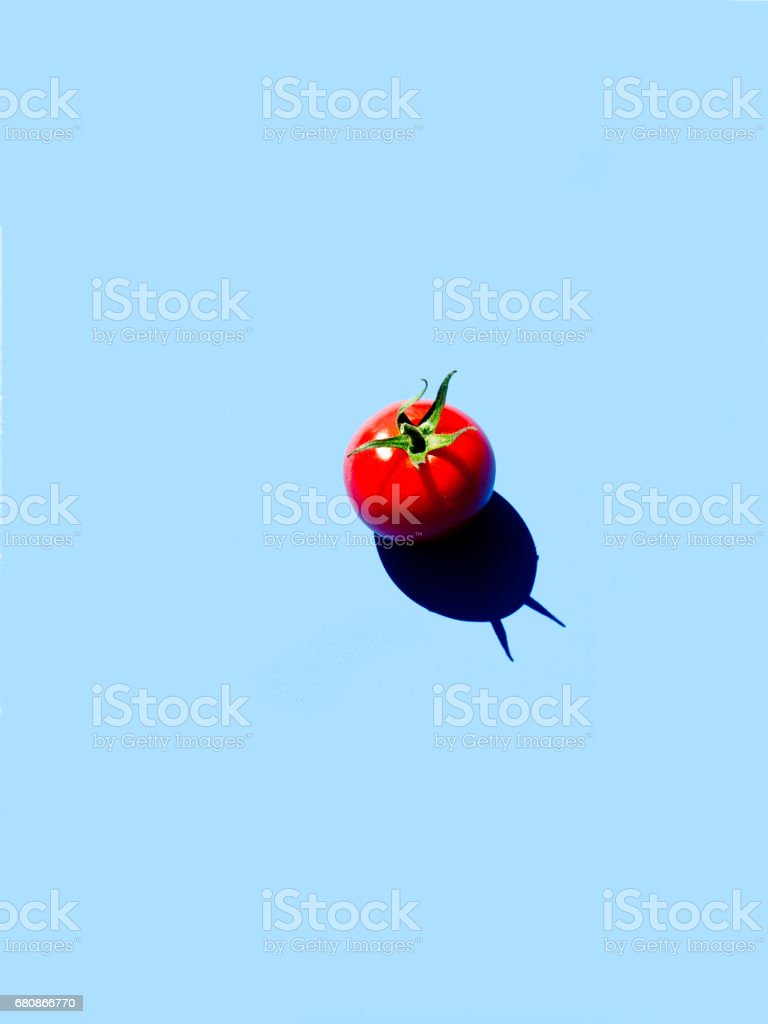Cherry tomatoes on blue royalty-free stock photo