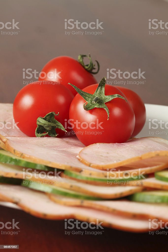 Cherry tomatoes on ham royalty-free stock photo
