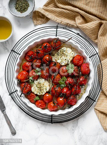Cherry tomatoes on the vine roasted with herbs and balsamic vinegar. Top view