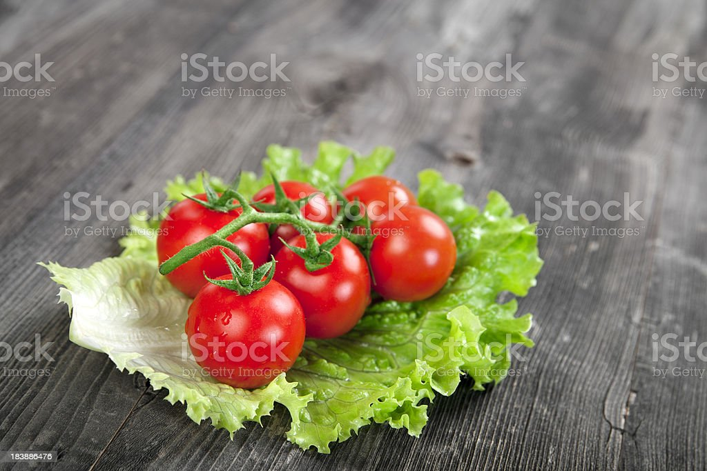 Cherry tomatoes with leaf lettuce royalty-free stock photo