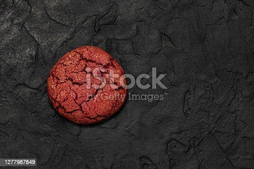 Cherry velvet cookies on a black background.