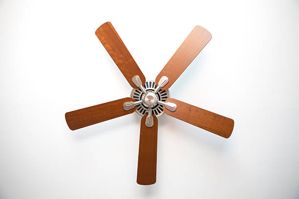 Cherry Wood and Brushed Metal Ceiling Fan Ceiling fan view from floor. ceiling fan stock pictures, royalty-free photos & images