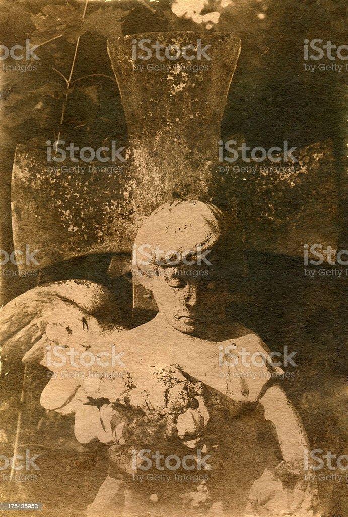 Cherub and big stone cross royalty-free stock photo