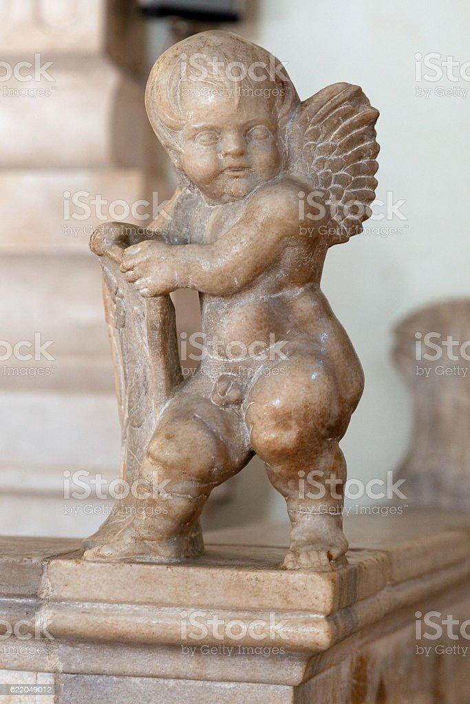 cherub at the Cathedral of Rimini-2 stock photo