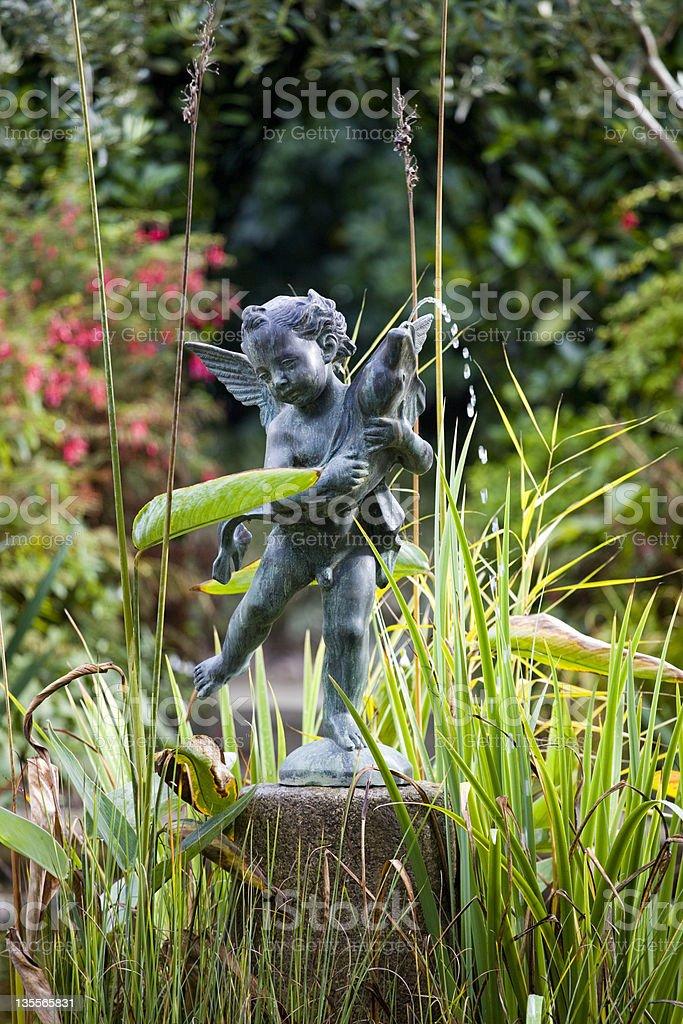 Cherub Fountain Bronze Statue With A Fish stock photo