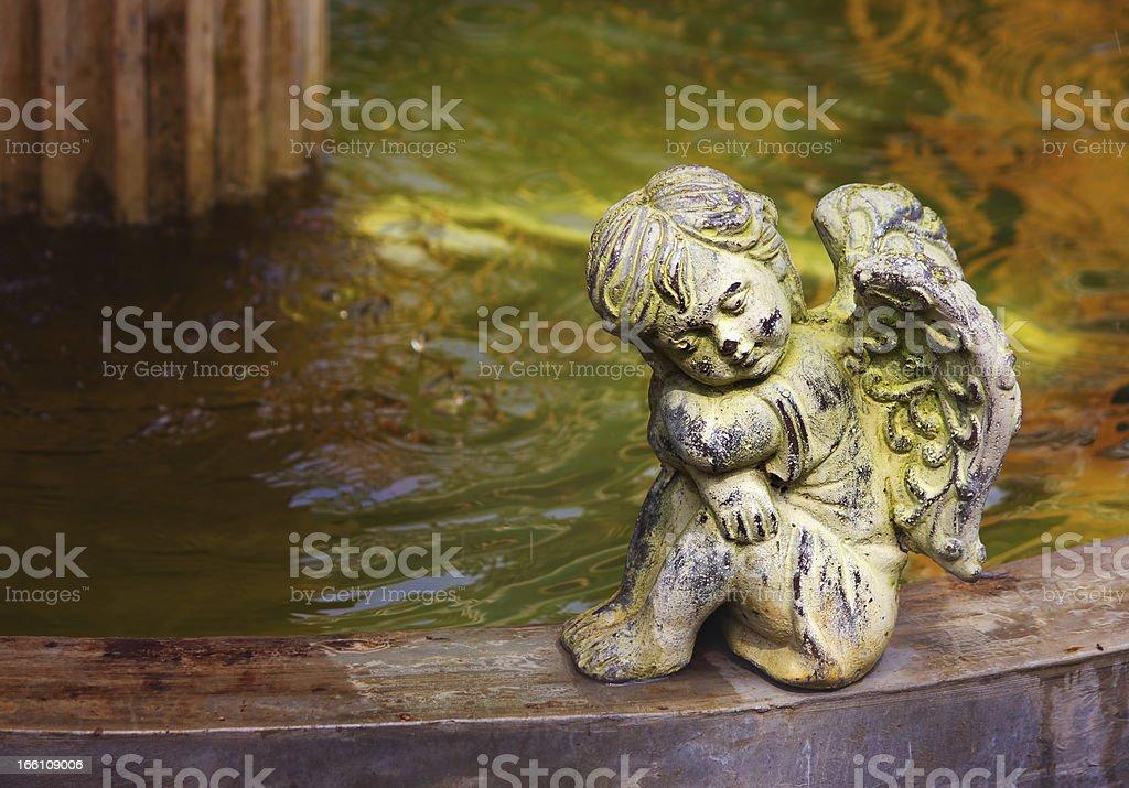 Cherub next to the fountain royalty-free stock photo