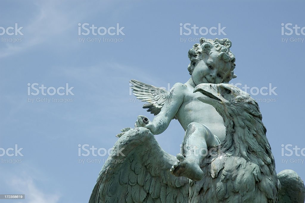 Cherub Riding an Eagle stock photo