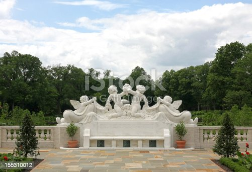 istock cherub statue in a garden 155310012