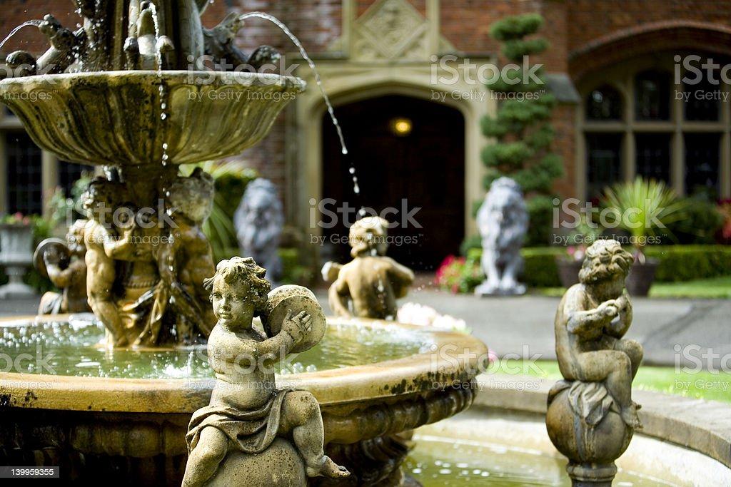 Cherubins and water fountain royalty-free stock photo