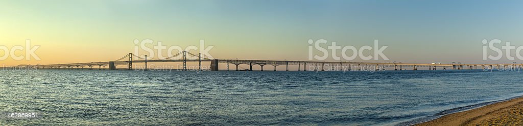 Chesapeake Bay Bridge Stretches Across Calm Water at Sunrise Panorama stock photo