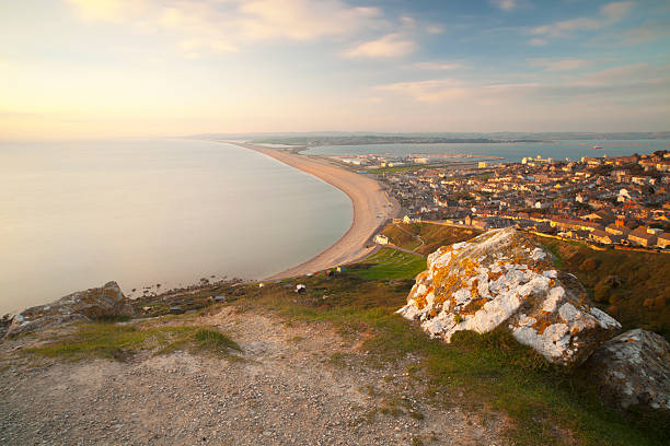 chesil beach and weymouth - weymouth stock photos and pictures