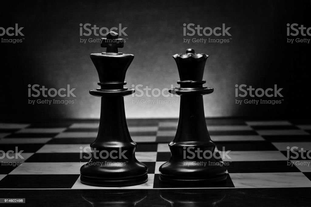 Chess. Black King and Queen on the board. stock photo