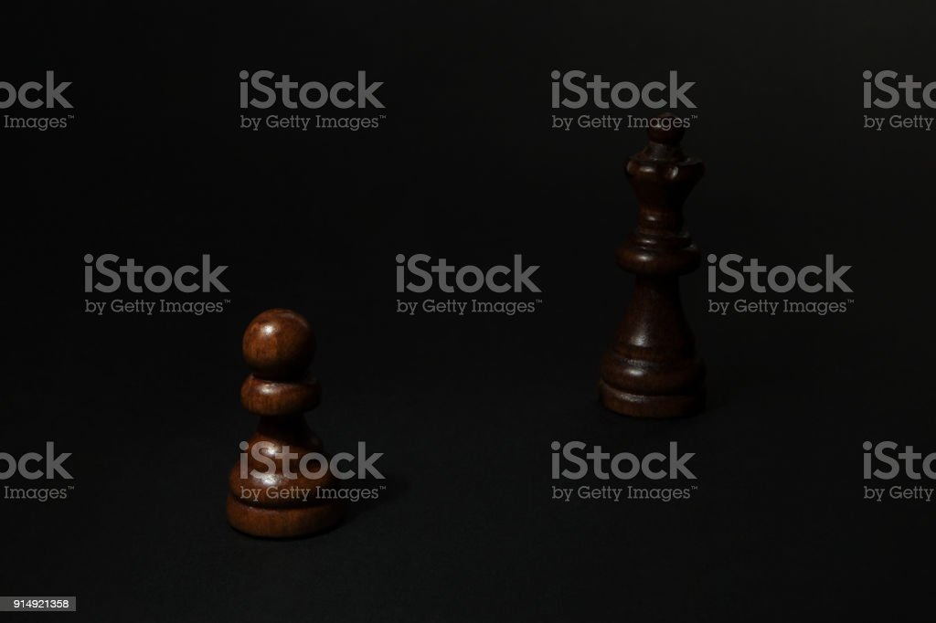 Chess. Black Pawn and Queen. stock photo