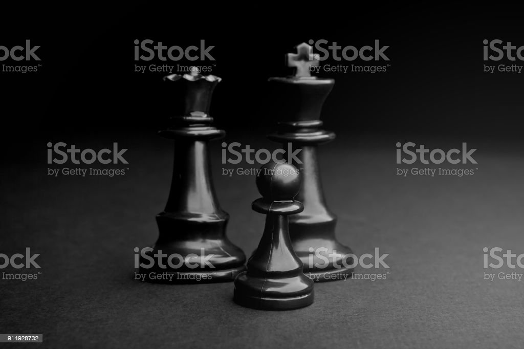 Chess. Black Pawn, King and Queen. stock photo