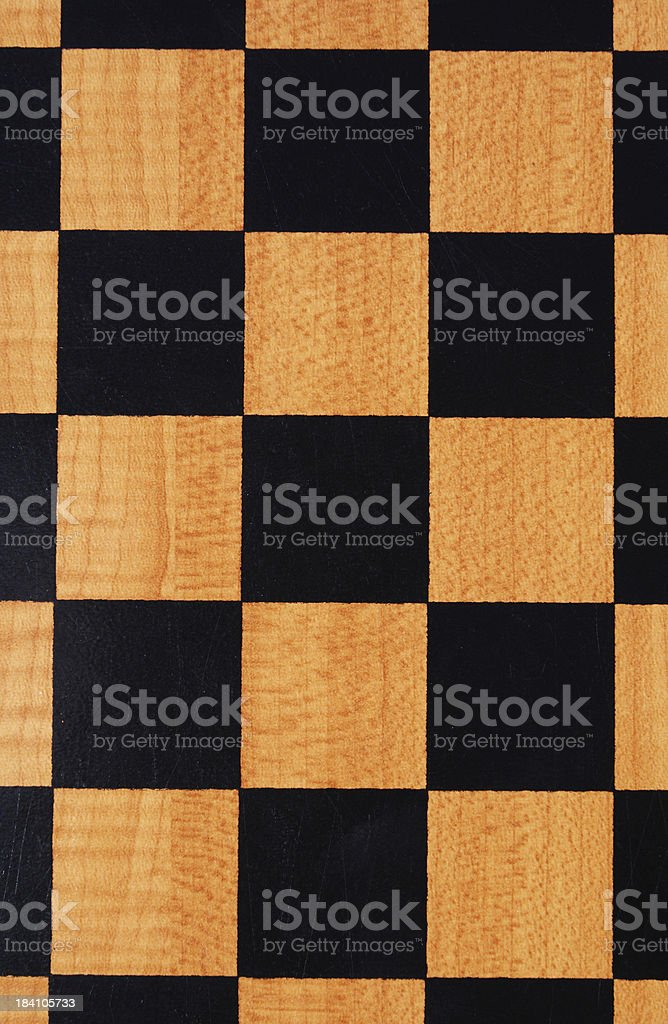 chess board background with woodgrain stock photo