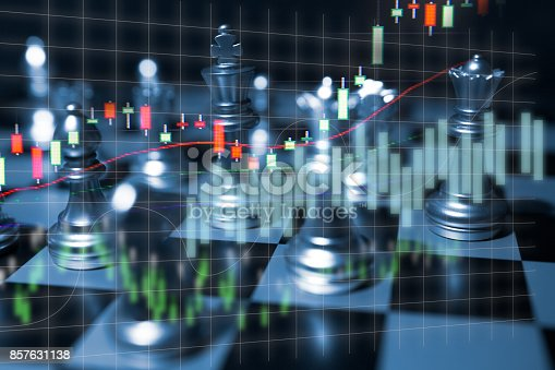 858031152istockphoto Chess board game concept of business competition and strategy with stock market graph background 857631138