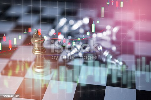 858031152istockphoto Chess board game concept of business competition and strategy with stock market graph background 858031042
