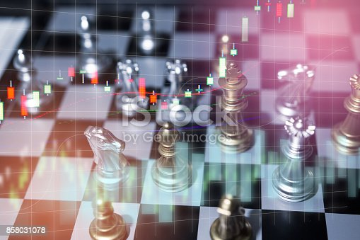 858031152istockphoto Chess board game concept of business competition and strategy with stock market graph background 858031078