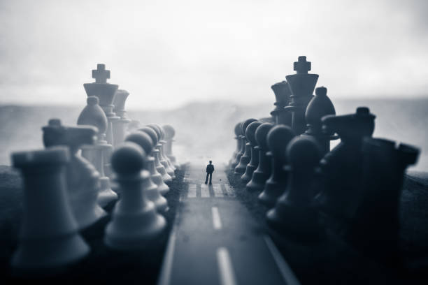Chess board game concept of business ideas and competition and strategy ideas concep. Chess figures on a dark background with smoke and fog. Selective focus – zdjęcie