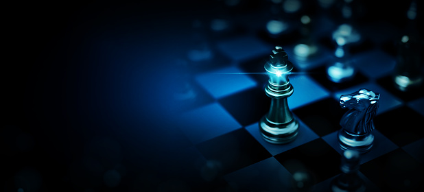 Chess board game to represent the business strategy with competition and challenging concept