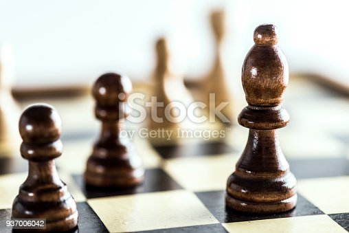 Pawn, bishop on chess board.