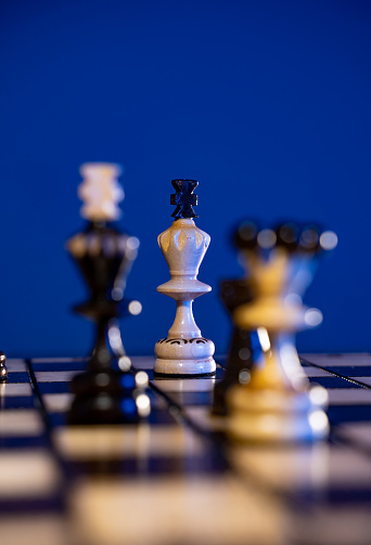 Chess board with chess pieces on blue background. Concept of business ideas and competition and strategy ideas.