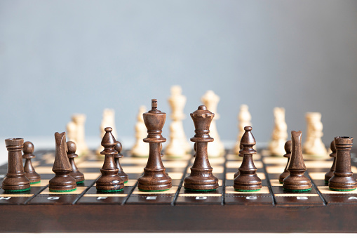 Chess board with figures. Board games, strategy and tactics. Copy space.