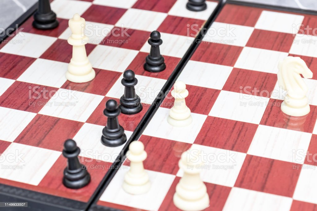 Chess board with figures on it close up, intellectual board games and...