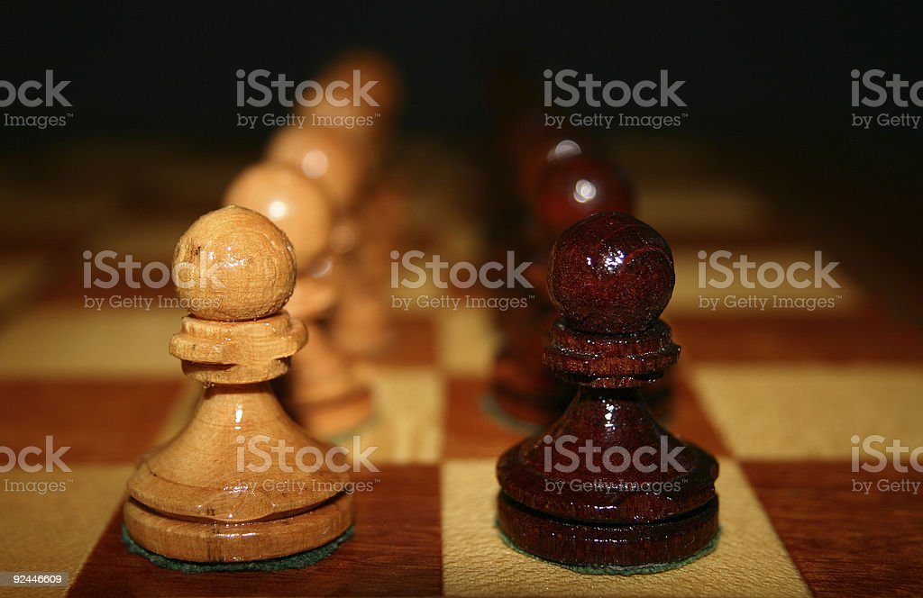 Chess figures lined up royalty-free stock photo